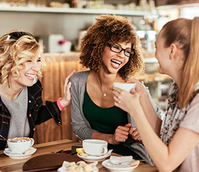 group of female friends getting coffee together