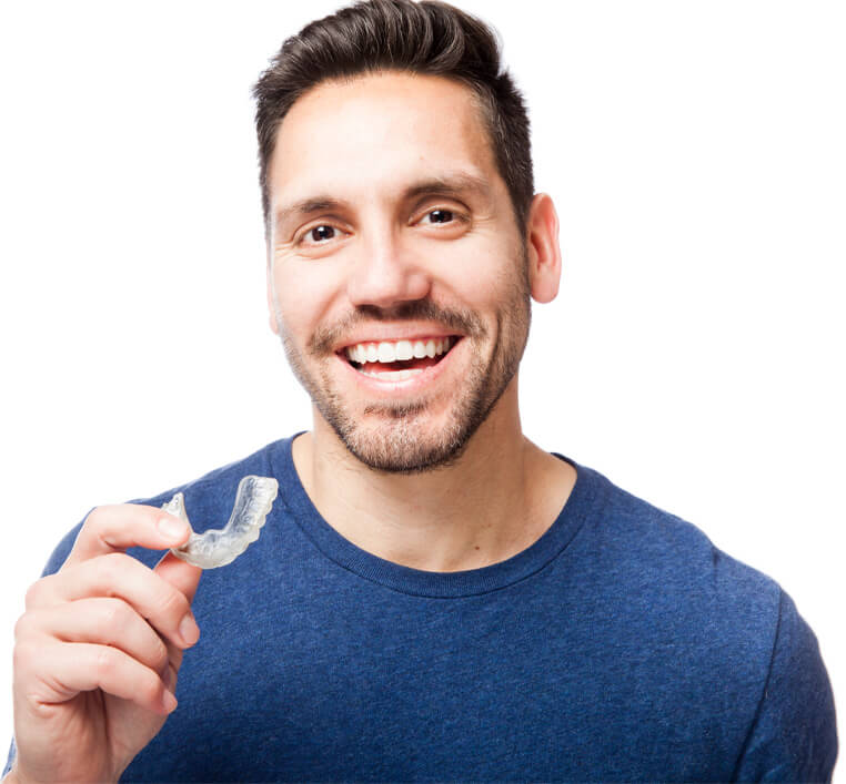 man holding his set of clear aligners